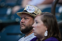 """A Winston-Salem Dash fan wears a hat with an """"I Love Bolt"""" button during the game against the Greensboro Grasshoppers at Truist Stadium on June 19, 2021 in Winston-Salem, North Carolina. (Brian Westerholt/Four Seam Images)"""