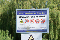 SIDCUP, KENT, ENGLAND - 21 MAY 2020<br /> .<br /> No bathing sign which was disregarded during the current government restricted lockdown of the COVID-19 worldwide pandemic with includes keeping a social distance of 2 metres at Foots Cray Meadow, Sidcup, England on 21 May 2020. Photo by Alan Stanford.