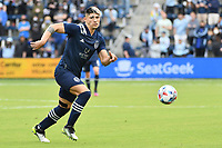 KANSAS CITY, KS - MAY 16: Alan Pulido #9 Sporting KC with the ball during a game between Vancouver Whitecaps and Sporting Kansas City at Children's Mercy Park on May 16, 2021 in Kansas City, Kansas.