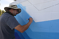 STEADY HAND<br />Graham Edwards, an artist from Bella Vista, decorates on Tuesday Aug. 15 2020 a building at the Rogers splash park. Edwards and a crew are decorating the splash park and skate park area with artwork. Both are located next to the Rogers Activity Center, 315 W. Olive St. Go to nwaonline.com/200916Daily/ to see more photos. <br />(NWA Democrat-Gazette/Flip Putthoff)