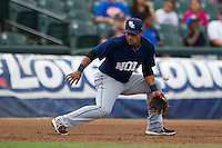 New Orleans Zephyrs third baseman Donovan Solano (17) commits an error on a ground ball during the Pacific Coast League baseball game against the Round Rock Express on June 30, 2013 at the Dell Diamond in Round Rock, Texas. Round Rock defeated New Orleans 5-1. (Andrew Woolley/Four Seam Images)