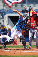 Charlotte Stone Crabs catcher Mac James (8) throws down to second as Mikey Reynolds (4) looks on during a game against the Palm Beach Cardinals on April 10, 2016 at Charlotte Sports Park in Port Charlotte, Florida.  Palm Beach defeated Charlotte 4-1.  (Mike Janes/Four Seam Images)