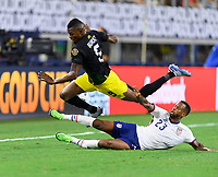 DALLAS, TX - JULY 25: Kellyn Acosta #23 of the United States trips up Cory Burke #9 of Jamaica while attempting to strip the ball from him during a game between Jamaica and USMNT at AT&T Stadium on July 25, 2021 in Dallas, Texas.