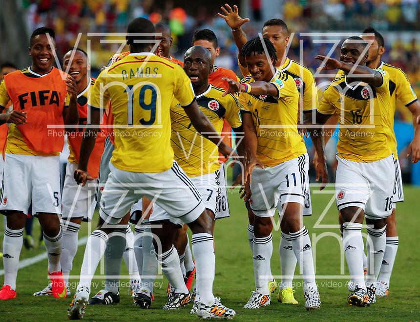 CUIABA - BRASIL -24-06-2014. Foto: Roberto Candia / Archivolatino<br /> Juan Cuadrado (#11), Pablo Armero (#7), Adrian Ramos (#19), Eder Balanta (#16) jugadores de Colombia (COL) celebran un gol anotado a Japón (JPN) durante partido del Grupo C de la Copa Mundial de la FIFA Brasil 2014 jugado en el estadio Arena Pantanal de Cuiaba./ Juan Cuadrado (#11), Pablo Armero (#7), Adrian Ramos (#19), Eder Balanta (#16) players of Colombia (COL) celebrate a goal scored to Japan (JPN) during the macth of the Group C of the 2014 FIFA World Cup Brazil played at Arena Pantanal stadium in Cuiaba. Photo: Roberto Candia / Archivo Latino<br /> VizzorImage PROVIDES THE ACCESS TO THIS PHOTOGRAPH ONLY AS A PRESS AND EDITORIAL SERVICE IN COLOMBIA AND NOT IS THE OWNER OF COPYRIGHT; ANOTHER USE IS REPONSABILITY OF THE END USER. NO SALES, NO MERCHANDASING. ALL COPYRIGHT IS ARCHIVOLATINO
