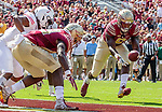 A Deondre Francois pass bounces off Florida State wide receiver Keith Gavin in the end zone only to be caught by Jacques Patrick at the one yard line for a Florida State touchdown against Northern Illinois University on September 22, 2018 in Tallahassee, Florida.  The Seminoles defeated the Huskies 37-19.