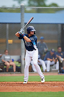 GCL Rays Dawson Dimon (14) at bat during a Gulf Coast League game against the GCL Pirates on August 7, 2019 at Charlotte Sports Park in Port Charlotte, Florida.  GCL Rays defeated the GCL Pirates 5-3 in the second game of a doubleheader.  (Mike Janes/Four Seam Images)