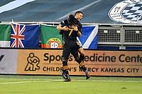 KANSAS CITY, UNITED STATES - AUGUST 25: Alberth Elis #7 and Christian Ramirez #13  of Houston Dynamo celebrate Dynamo goal  a game between Houston Dynamo and Sporting Kansas City at Children's Mercy Park on August 25, 2020 in Kansas City, Kansas.