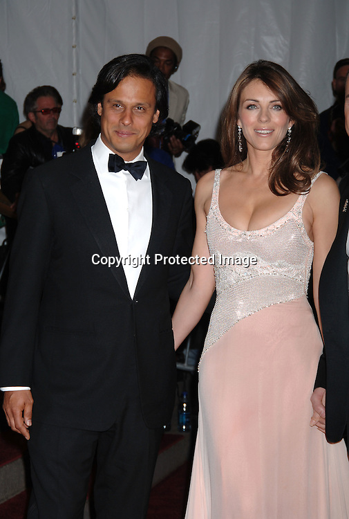 Arun Nayer, Elizabeth Hurley ..arriving to the Costume Institute Gala celebrating AngloMania on May 1, 2006 at The Metropolitan Museum of ..Art. ..Robin Platzer, Twin Images..
