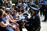 Families of fallen officers are presented with flags by the Nevada Legislative Police during the annual Nevada Law Enforcement Officers Memorial ceremony, in Carson City Nev., on Thursday, May 6, 2021.<br /> Photo by Cathleen Allison