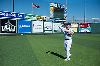 Everett AquaSox pitch Cody Mobley (12) throws a football before a Northwest League game against the Tri-City Dust Devils at Everett Memorial Stadium on September 3, 2018 in Everett, Washington. The Everett AquaSox defeated the Tri-City Dust Devils by a score of 8-3. (Zachary Lucy/Four Seam Images)