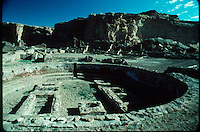 This great kiva at Pueblo Bonito (ruin in background) in Chaco Canyon in Central New Mexico shows a circular bench around the wall and numerous floor features archaeologists believe may have been part of ceremonial life for the prehistoric Anasazi people who lived here around 1000ad..