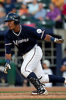 Salvador Perez (39) of the Northwest Arkansas Naturals follows through on his swing during a game against the San Antonio Missions at Arvest Ballpark on June 30, 2011 in Springdale, Arkansas. (David Welker / Four Seam Images)