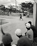Ragtag Baseball.Baseball in the Domincan Republic .On a recent trip to the Dominican Republic I was inspired by these ballplayers. This scene was in the Southwest part of Hispaneola. They play with equipment so battered and bruised I am not sure how they play so well. The team has a regular afternoon practice like a thousand days before. Baseball hasn't changed here since it's first introduction to the island. Punta Cana, DR. 2006...