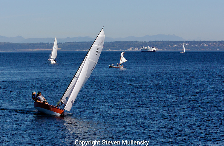 Blue skies and brisk winds and the majestic Cascade Range in the background make for ideal conditions for a Sunday afternoon sail on Port Townsend Bay.
