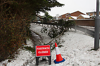 Branches of Trees collapse along a public footpath under the weight of fallen snow - Weather - the Snowfall in the Wycombe area, England on 11 December 2017. Photo by Andy Rowland.