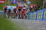 Danish Champion Kasper Asgreen (DEN) Elegant-Quick Step, Dutch Champion Mathieu van der Poel (NED) Alpecin Fenix and Christophe Laporte (FRA) Cofidis lead the pack up the Paterberg during the 2021 Tour of Flanders running 254.3km from Antwerp to Oudenaarde, Belgium. 4th April 221.  <br /> Picture: Serge Waldbillig | Cyclefile<br /> <br /> All photos usage must carry mandatory copyright credit (© Cyclefile | Serge Waldbillig)