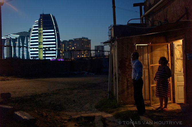 Yeni Hayat, or New Life building is seen in the background from 19th century worker's homes for a shipbuilding factory in Black City, the most polluted part of Baku, Azerbaijan.