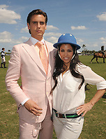 WEST PALM BEACH, FL - MARCH 14:  Kourtney Kardashian and Scott Disick with their young son Mason Dash Disick in tow take a polo lesson with top ranked american polo player Nic Roldan. The couple was joined by sister Khloe Kardashian. The kardashian clan had a great afternoon, riding horses and joking around while they sipped champagne at the International polo club palm beach on March 14, 2010 in Wellington, Florida.<br /> <br /> <br /> People:  Kourtney Kardashian, Scott Disick
