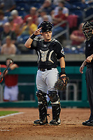 West Virginia Black Bears catcher Grant Koch (51) and home plate umpire Benjamin Engstrand during a game against the State College Spikes on August 30, 2018 at Medlar Field at Lubrano Park in State College, Pennsylvania.  West Virginia defeated State College 5-3.  (Mike Janes/Four Seam Images)