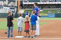 Young baseball fans with Round Rock Express first baseman Chad Tracy during the pre-game national anthem at the Dell Diamond on July 10, 2011in Round Rock, Texas.  Memphis defeated Round Rock 10-9.  (Andrew Woolley / Four Seam Images)