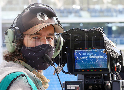 16th May 2020, Rhein-Neckar-Arena, Hoffenheim, Germany; Bundesliga football,1899 Hoffenheim versus Hertha Berlin; TV cameraman with mask for protection