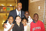 Scholastic President Greg Worrell with the Young Elementary School students he read to the first time when they were in fourth grade. Bradford Tanner is on the right.