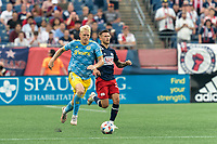 FOXBOROUGH, MA - AUGUST 8: Jakob Glesnes #5 of Philadelphia Union brings the ball forward during a game between Philadelphia Union and New England Revolution at Gillette Stadium on August 8, 2021 in Foxborough, Massachusetts.