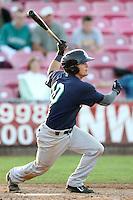 Eugene Emeralds outfielder Justin Miller #10 bats against the Salem-Keizer Volcanoes at Volcanoes Stadium on August 9, 2011 in Salem-Keizer,Oregon. Eugene defeated Salem-Keizer 13-7.(Larry Goren/Four Seam Images)