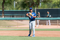 Los Angeles Dodgers third baseman Marcus Chiu (22) throws to first base during an Instructional League game against the Oakland Athletics at Camelback Ranch on September 27, 2018 in Glendale, Arizona. (Zachary Lucy/Four Seam Images)