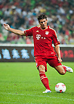 GUANGZHOU, GUANGDONG - JULY 26:  Mario Gomez of Bayern Munich in action during a friendly match against VfL Wolfsburg as part of the Audi Football Summit 2012 on July 26, 2012 at the Guangdong Olympic Sports Center in Guangzhou, China. Photo by Victor Fraile / The Power of Sport Images