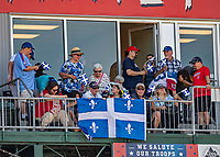 23 June 2019: Fans from Quebec, Canada celebrate St. Jean Baptiste Day while enjoying a baseball game between the New Hampshire Fisher Cats and the Trenton Thunder at Northeast Delta Dental Stadium in Manchester, NH. All PA announcement at the game were delivered in both English and French reminiscent of ballgames played in Montreal in years past. The Thunder defeated the Fisher Cats 5-2 in Eastern League play. Mandatory Credit: Ed Wolfstein Photo *** RAW (NEF) Image File Available ***