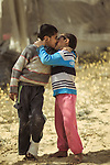 Two boys kiss each other. Photo by Sanad Ltefa