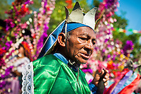 """A member of a dance group """"Los Historiantes"""" performs the Dance of the Moors and Christians during the Flower & Palm Festival in Panchimalco, El Salvador, 8 May 2011. On the first Sunday of May, the small town of Panchimalco, lying close to San Salvador, celebrates its two patron saints with a spectacular festivity, known as """"Fiesta de las Flores y Palmas"""". The origin of this event comes from pre-Columbian Maya culture and used to commemorate the start of the rainy season. Women strip the palm branches and skewer flower blooms on them to create large colorful decoration. In the afternoon procession, lead by a male dance group performing a religious dance-drama inspired by the Spanish Reconquest, large altars adorned with flowers are slowly carried by women, dressed in typical costumes, through the steep streets of the town."""