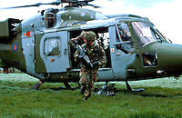 British Army soldiers exiting a Lynx helicopter to start foot patrol in the countryside of Northern Ireland. This image may only be used to portray the subject in a positive manner..©shoutpictures.com..john@shoutpictures.com
