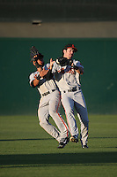Ronnie Jebavy (1) of the San Jose Giants catches a fly ball while bumping into teammate Cristian Paulino (9) during a game against the Lancaster JetHawks at The Hanger on August 13, 2016 in Lancaster, California. Lancaster defeated San Jose, 16-2. (Larry Goren/Four Seam Images)