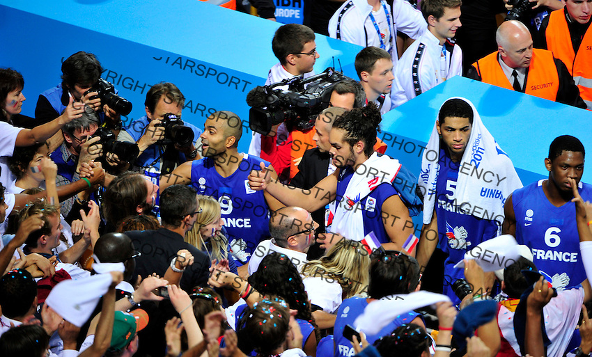 French national basketball players Tony Parker, Joakim Noah, Nicolas Batum and Seraphin Kevin celebrate second place with supporters after final Eurobasket 2011 game between Spain and France in Kaunas, Lithuania, Sunday, September 18, 2011. (photo: Pedja Milosavljevic)
