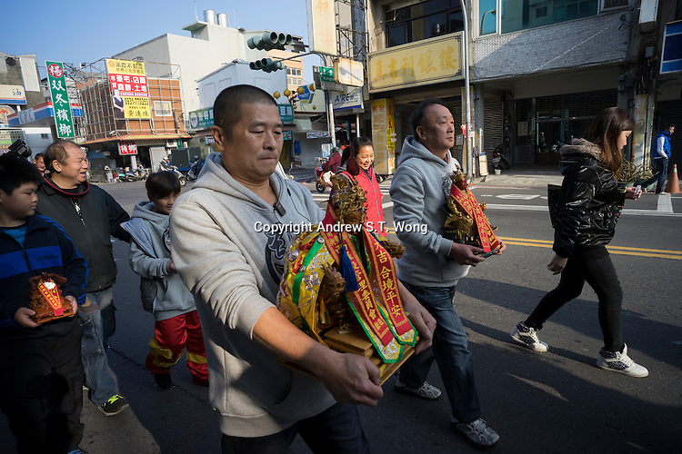 Believers take part in a procession to celebrate the birthday of the Reverent King of Broad Grace near the Xiluo Temple in Tainan, Taiwan, 2015.