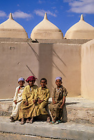 Jalan Bani Bu Ali, Oman.  Pre-teen Omani Boys Sitting outside the Mosque of Rashid bin Hamouda, Jalan Bani Bu Ali.