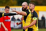 Tempers flare as Grant 'Rhino' Ryan of Hucknall Town suffers a cut to the back of the head after a challenge from Jake Carlisle of Heanor Town, (not pictured). from Hucknall Town v Heanor Town, 17th October 2020, at the Watnall Road Ground, East Midlands Counties League. Photo by Paul Thompson.