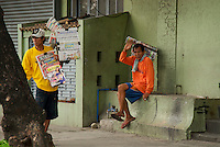 street vendors on the sidewalk view from the car window Manila, Philippines