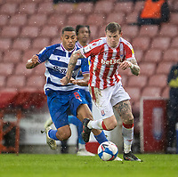 6th February 2021; Bet365 Stadium, Stoke, Staffordshire, England; English Football League Championship Football, Stoke City versus Reading; James McClean of Stoke City has his eye on the ball as heavy rain starts to fall