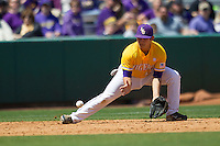 LSU Tigers third baseman Christian Ibarra #14 fields a ground ball against the Auburn Tigers in the NCAA baseball game on March 24, 2013 at Alex Box Stadium in Baton Rouge, Louisiana. LSU defeated Auburn 5-1. (Andrew Woolley/Four Seam Images).