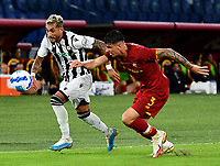 Calcio, Serie A: AS Roma vs Udinese, Olympic stadium, September 23, 2021.<br /> Roma's Roger Ibanez (R) in action with Udinese's Roberto Pereyra (L) during the Italian Serie A football match between Roma and Udinese at Rome's Olympic stadium, on September 23, 2021.<br /> UPDATE IMAGES PRESS/Isabella  Bonotto