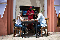 "BOGOTA - COLOMBIA, 05-09-2020: Un mesero toma el pedido de unos clientes durante el primer día del piloto de apertura de restaurantes y cafés al aire libre, denominado ""Bogotá a Cielo Abierto"", en el Chorro de Quevedo en el centro de Bogotá que ahora tiene sus calles pintadas con formas geométricas en pintura neón y cuenta con mesas, distribuidas estratégicamente para mantener el distanciamiento físico al finalizar la cuarentena total en el territorio colombiano causada por la pandemia  del Coronavirus, COVID-19. / A waiter takes the order from the customers during the first day of the pilot for the opening of restaurants and outdoor cafes, called ""Bogotá a Cielo Abierto"", in Chorro de Quevedo in the center of Bogotá, which now has its streets painted with geometric shapes in neon paint and has tables, strategically distributed to maintain physical distancing at the end of the total quarantine in the Colombian territory caused by the Coronavirus pandemic, COVID-19. Photo: VizzorImage / Johan Rugeles / Cont"