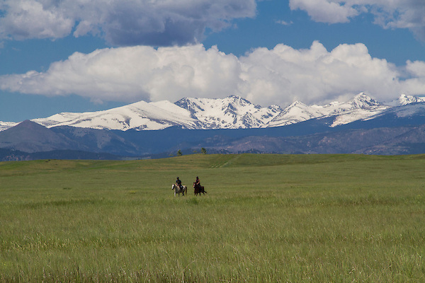 Horseback riders in meadow in Boulder, Colorado, .  John leads private photo tours in Boulder and throughout Colorado. Year-round.