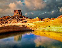 Reflection of rock formations in pool on banks of Lake Powell, Utah.