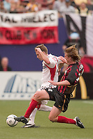 the MetroStars' Eddie Gaven goes for a tackle on D.C. United's Bryan Namoff. D. C. United was defeated by the NY/NJ MetroStars 3 to 2 during the MetroStars home opener at Giant's Stadium, East Rutherford, NJ, on April 17, 2004.