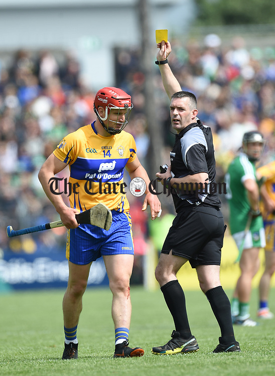 James Owens yellow cards John Conlon of Clare during their Munster championship game in Ennis. Photograph by John Kelly.