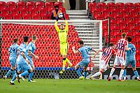 21st April 2021; Bet365 Stadium, Stoke, Staffordshire, England; English Football League Championship Football, Stoke City versus Coventry; Goalkeeper Angus Gunn of Stoke City makes a save high above his bar