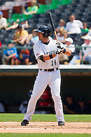 Travis Ishikawa (14) of the Charlotte Knights at bat against the Gwinnett Braves at Knights Stadium on July 28, 2013 in Fort Mill, South Carolina.  The Knights defeated the Braves 6-1.  (Brian Westerholt/Four Seam Images)